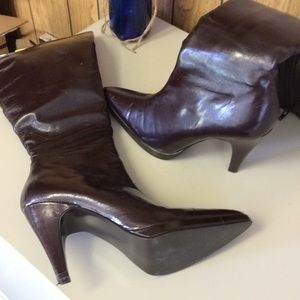Brown faux leather boots. Knee high length